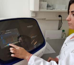 A scientist uses the SeqStudio Genetic Analyzer