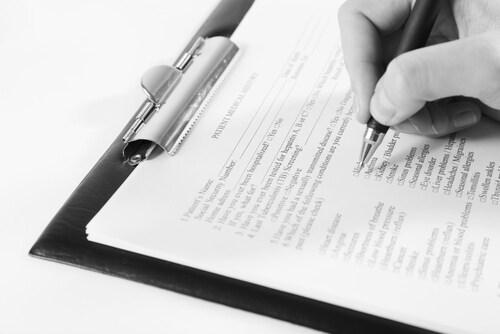 Filling out a medical form. Image: Africa Studio/Shutterstock.com