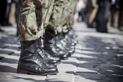 Row of army boots. Image: Rafal Olkis/Shutterstock.com