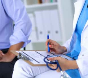 Doctor with patient. Image: sheff/Shutterstock.com