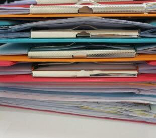 Stack of clipboards. Image: NINUN/Shutterstock.com