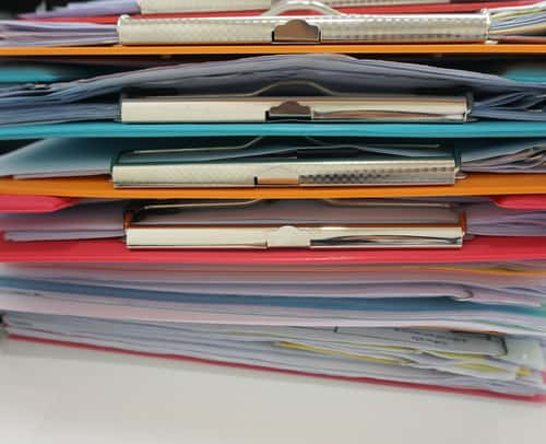Stack of clipboards. Image: NINUN/Shutterstock.com