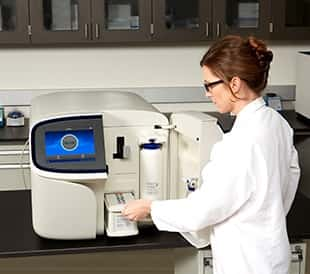 Scientist using Sequencer in lab