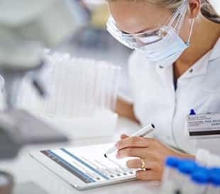 Scientist using LIMS on a Tablet
