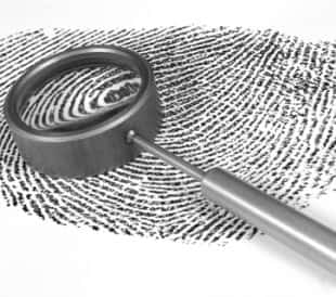 Fingerprint picture with magnifying glass - almost a biomarker...