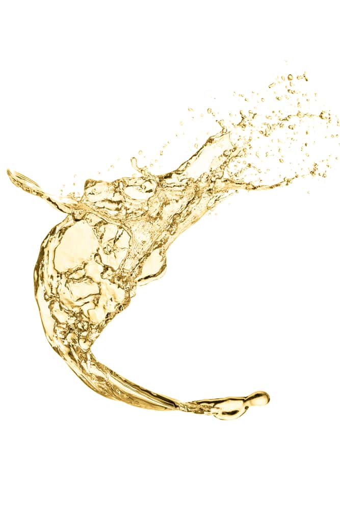 Splash of white wine, isolated on a white background