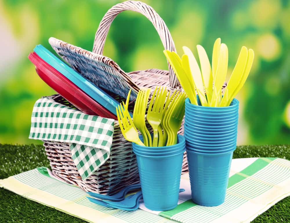 Bright plastic tableware on grass
