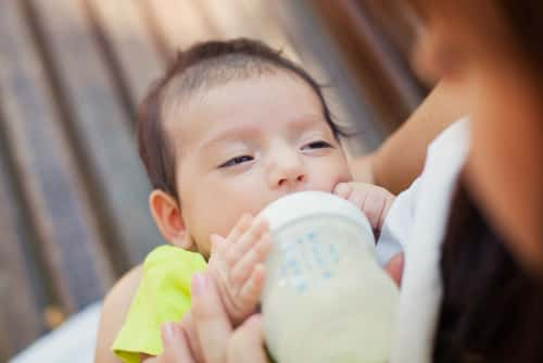 Baby with milk formula