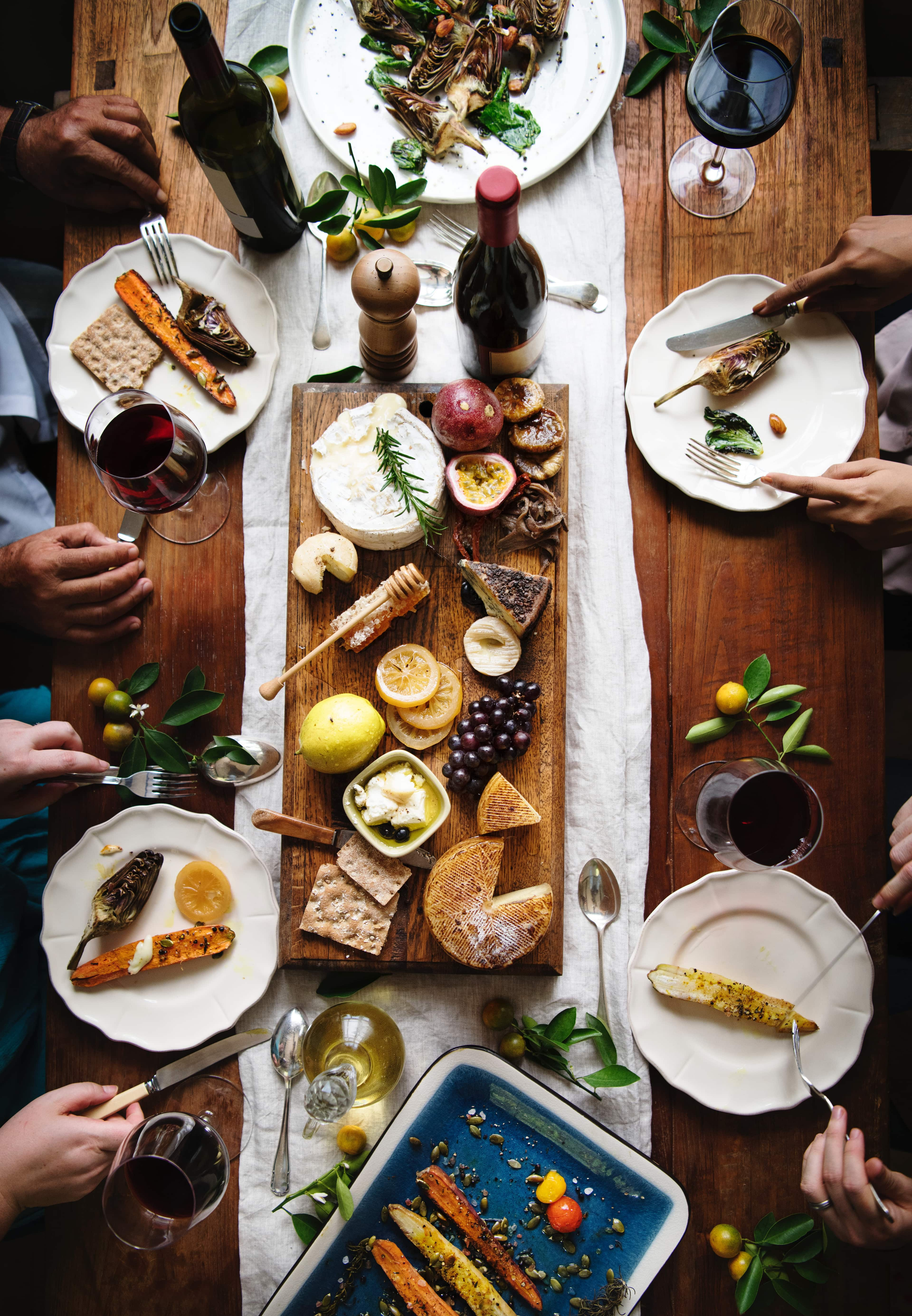 Food Policy for Canada helps make meals like this one possible. A table full of food and wine is seen from above.
