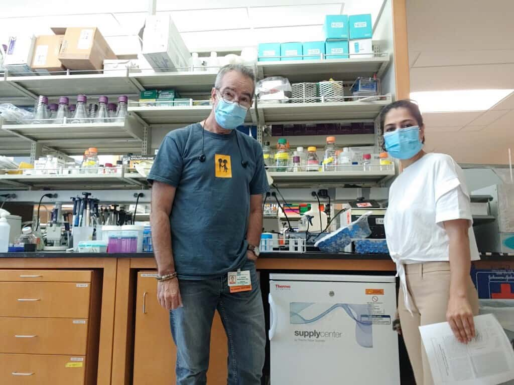 Two researchers wearing face masks in a UCLA laboratory