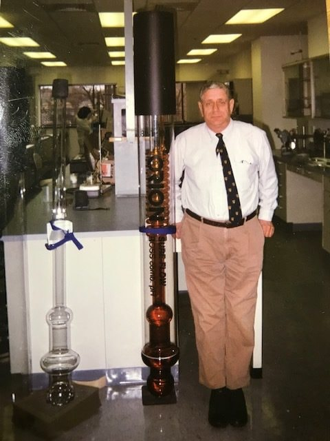 Moshe Hirshberg stands next to an oversized version of a ROSS Sure-Flow Electrode.