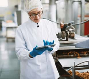 Quality control professional checks quality in food plant