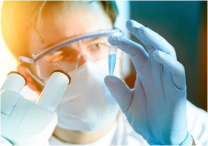 Scientist examining liquid in microcentrifuge tube