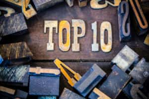 The words TOP 10 written in rusted metal letters surrounded by vintage wooden and metal letterpress type.