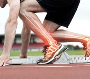 Digital composite of highlighted bones of man about to race. Image: ESB Professional/Shutterstock.com.