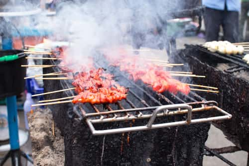 Smoky pork grill, meat cooked at high temperatures danger food and cancer risk from heterocyclic amines (HCAs) and polycyclic aromatic hydrocarbons (PAHs). Image: Microstock-Thailand/Shutterstock.com.
