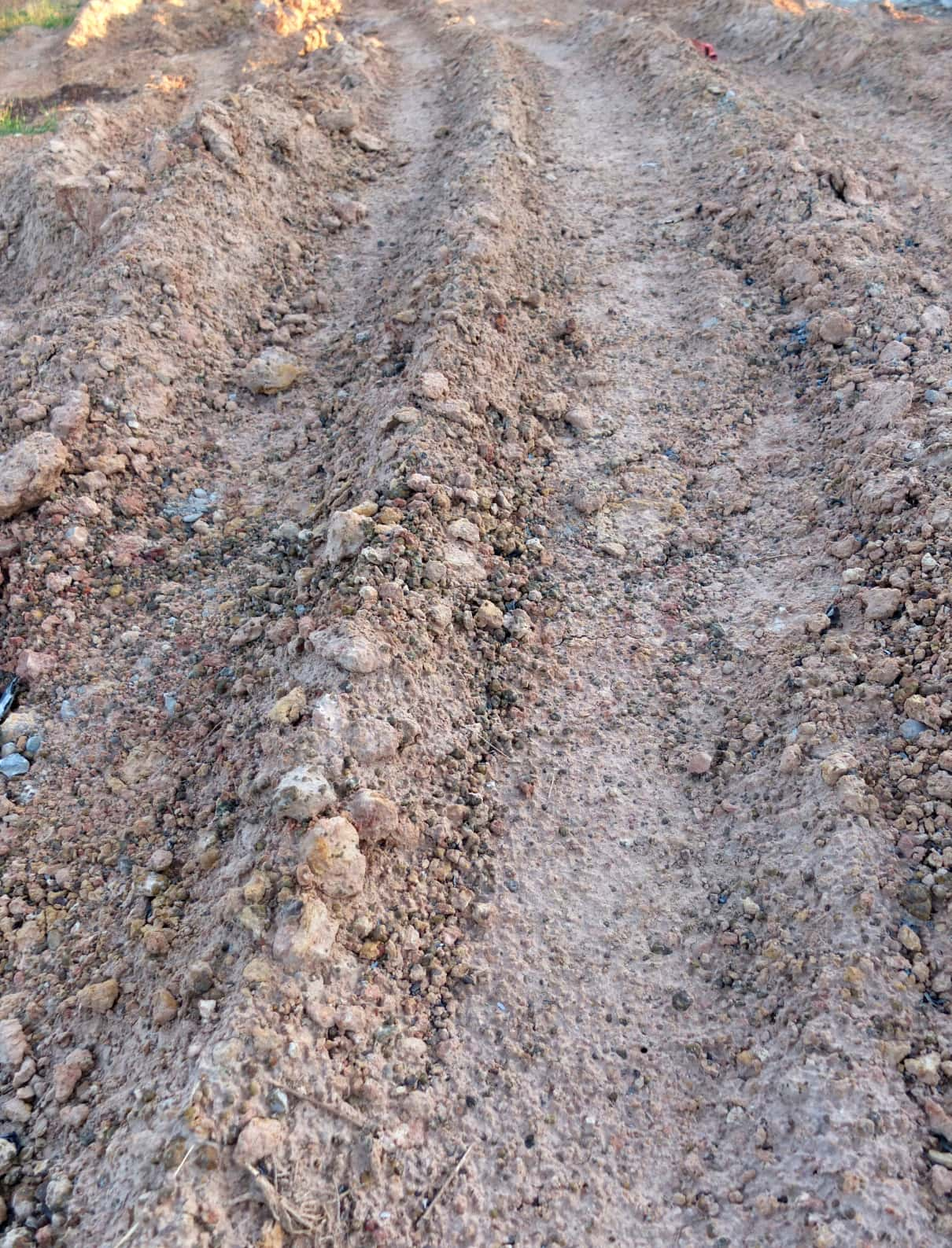 Wheel track in laterite soil excavation site, texture