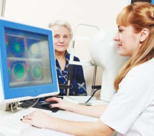 Optometry concept. Female optometrist optician doctor evaluate eyesight of female patient in eye ophthalmological clinic. Image: Dmitry Kalinovsky/Shutterstock.com.