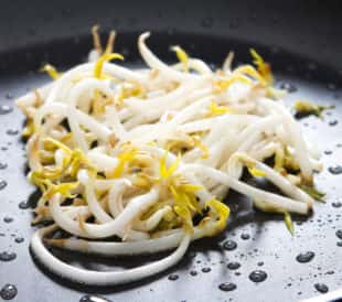Mung bean sprouts in a black pan