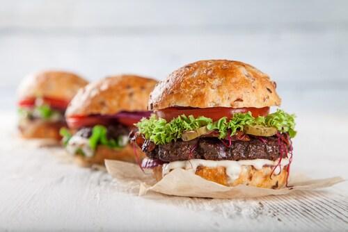 Close-up of three hamburgers. Image: Lukas Gojda/Shutterstock.com