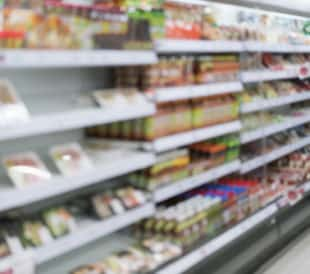Blurred out image of supermarket shelves. Image: Pushish Images/Shutterstock.com