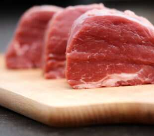 Raw beef on a wooden board. Image: Eviart/Shutterstock.com