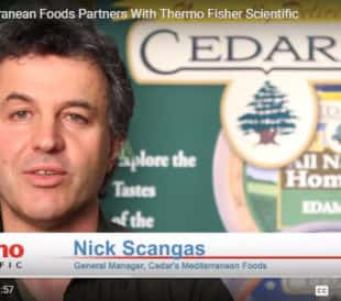 Still from video showing general manager of Cedar's Mediterranean Foods.