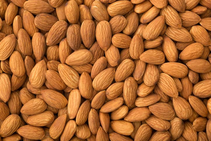 An image filed with raw almonds demonstrates the need for quality control in almond processing. Image courtesy of iStock.