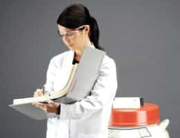 biobank professional with binder and cryo container