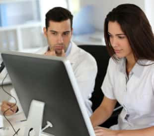 Two scientists filling out an online survey. Image: Goodluz/Shutterstock.com