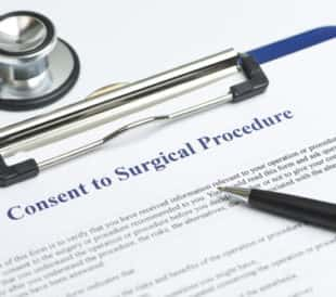 Surgical consent form. Image: Sherry Yates Young/Shutterstock.com