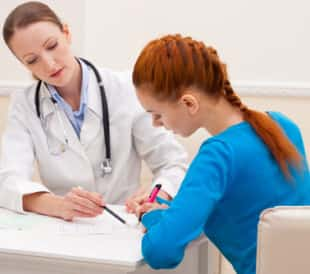 Doctor advises woman patient. Image: NotarYES/Shutterstock.com.