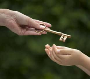 Mother handing key to daughter. Image: eelnosiva/Shutterstock.com.