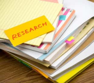 Research; the pile of business documents on the desk. Image: Eiko Tsuchiya/Shutterstock.com.