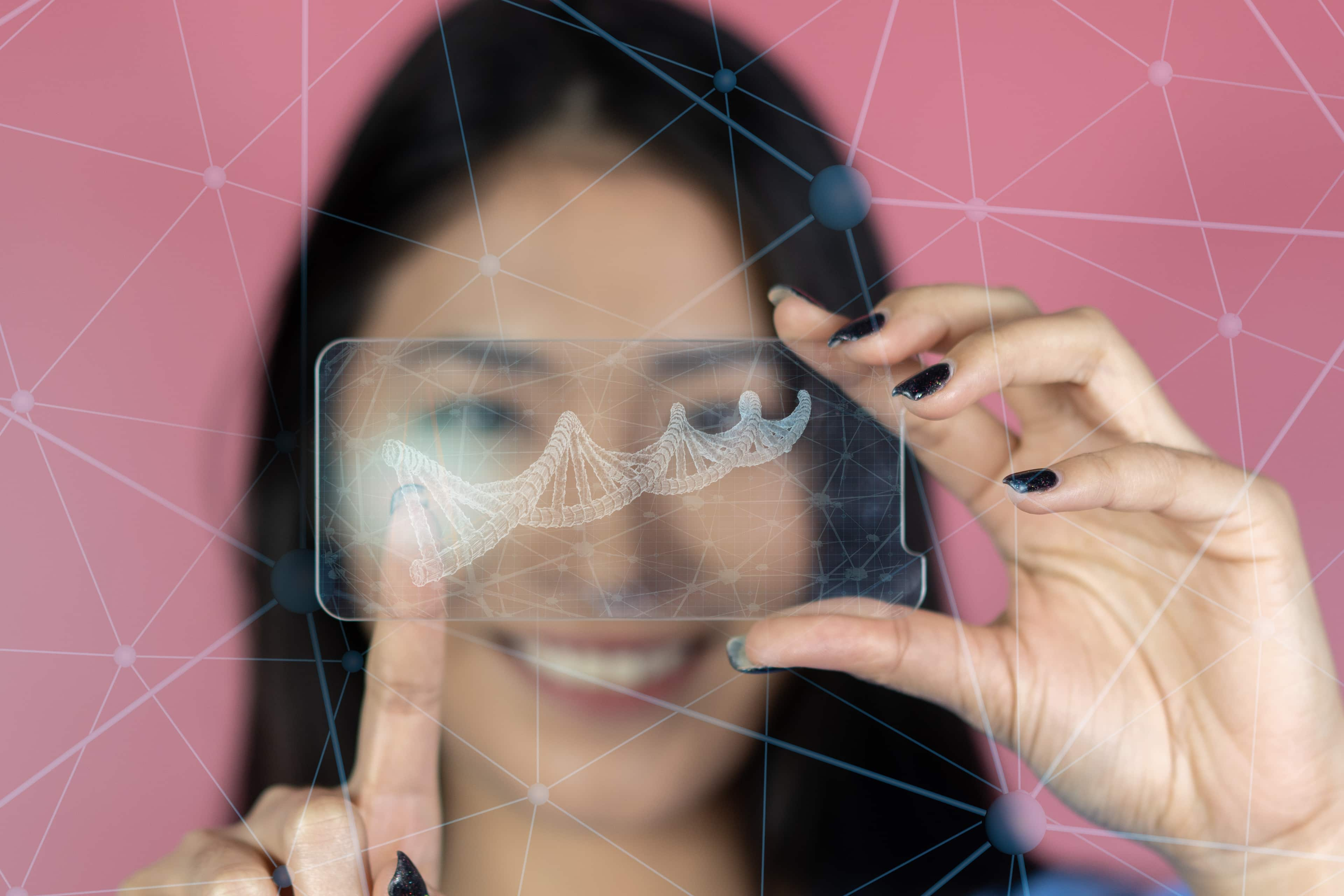 A woman looks at the camera through a graphic of a DNA double helix